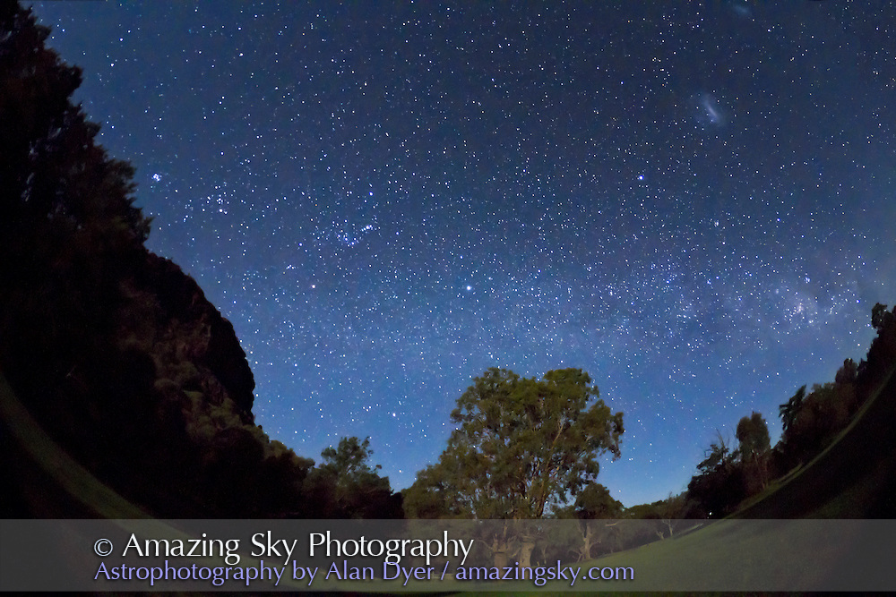 The southern Milky Way over Timor Cottage, near Coonabarabran, NSW, Australia. Looking east toward Orion and the Milky Way rising. Taken in moonlight, Dec 12, 2010, with Canon 7D camera and 8mm Sigma lens for 40 seconds at f/3.5 at ISO 3200. Dark corners at top filled in with Content-Aware Fill.