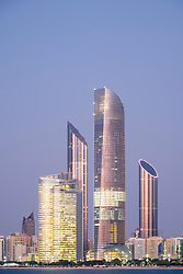 Evening view of modern skyscrapers on Corniche in Abu Dhabi United Arab Emirates