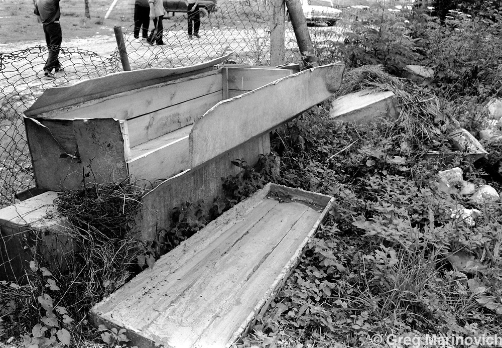 The wood and aluminium Soviet armmy coffins in which slain Chechen conscripts were brought back from the 1970-1980's war in Afghanistan in a cemetery near Vedeno, Chechnya, 1995. The bodies were taken out of the coffins and reburied in  the Moslem fashion. Greg Marinovich/Getty Images