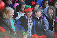 Braylon Young wears an elf hat as he and other Bramlett Elementary students sing Christmas carols outside of City Hall, in Oxford, Miss. on Tuesday, December 10, 2013.