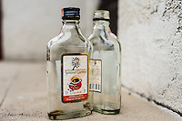A couple of empty bottles of Summer Garden Liqueur in an area of housing in Vilnius, Lithuania.