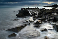 Incoming tide on a rocky promontory, Crail, East Neuk (East Corner), Fife, Scotland.