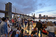 Crowd of people at the embankment,<br /> East River, New York City.