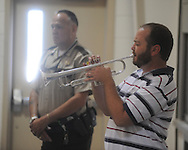 "Jonathan Whitmire plays ""Taps"" during a Memorial Day service at the National Guard Armory in Oxford, Miss. on Monday, May 31, 2010."
