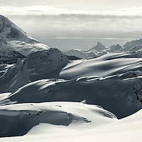 The Coast Mountain range of British Columbia provide an inhospitable landscape on a hazy winter day.