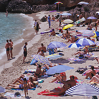 Summer time in Mallorca, People sunbathing on the sand.