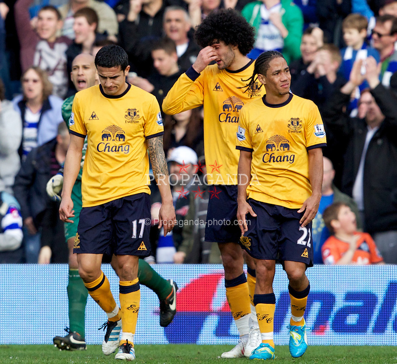 LONDON, ENGLAND - Saturday, March 3, 2012: Everton's Tim Cahill, Marouane Fellaini and Steven Pienaar look dejected as Queens Park Rangers score the equalising 1-1 goal during the Premiership match at Loftus Road. (Pic by Vegard Grott/Propaganda)