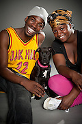 Davvonn Bailey and Darease Brown pose with Bailey, four months, an American Staffordshire terrier puppy.