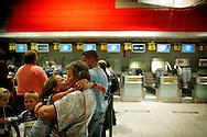 Angelia Yatsenko, 11 hugs and kisses Cidália Santos at Lisbon International airport just before departing to Ukraine again.