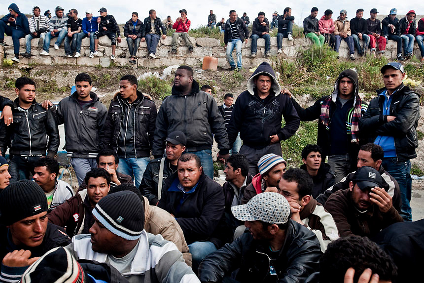 Northern African refugees rest in the portual area of the Lampedusa Island. Vessels packed with would be immigrants continue to land in the Island where more than 5000 thousands refugees rest The portual area of Lampedusa has become a second open air immigration centre where immigrants live in critical igenic and sanitary conditions.