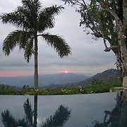 Sunset as seen from infinity edge pool at Strawberry Hill in the Blue Mountains near Kingston, Jamaica. Peaceful oasis!