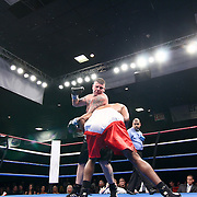 "Cruiserweight boxing pro Brain ""Widman"" Donahue (LEFT) in action against Cruiserweight boxing pro Lamont Singletary of Dover, Delaware during champs at the chase Friday, Nov 21, 2014 at The Case Center on The River Front in Wilmington, Del."