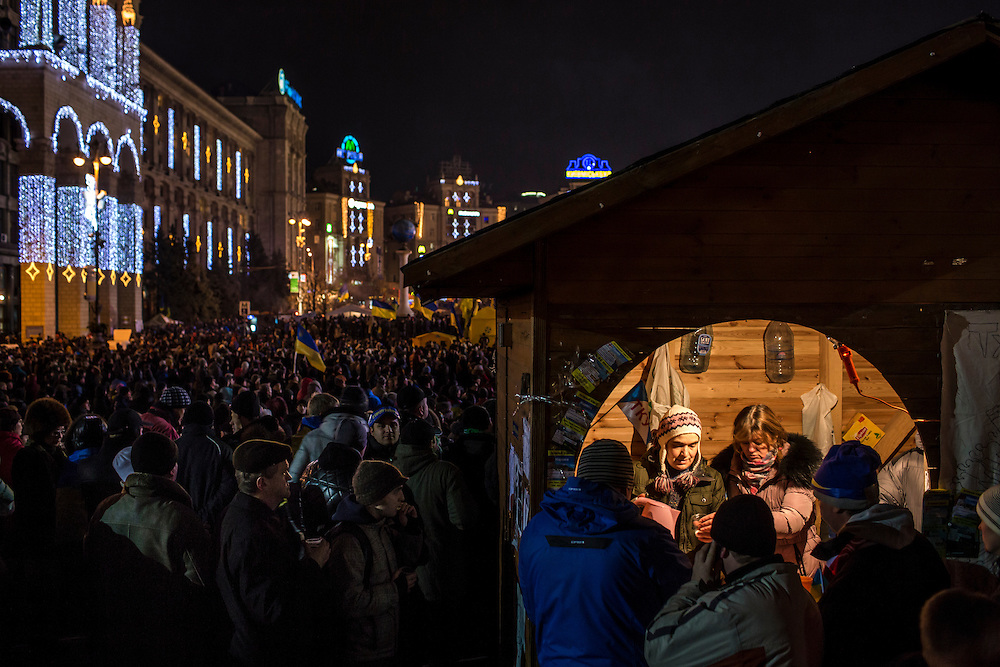 KIEV, UKRAINE - DECEMBER 4: People serve tea to anti-government protesters from a small booth in Independence Square on December 4, 2013 in Kiev, Ukraine. Thousands of people have been protesting against the government since a decision by Ukrainian president Viktor Yanukovych to suspend a trade and partnership agreement with the European Union in favor of incentives from Russia. (Photo by Brendan Hoffman/Getty Images) *** Local Caption ***