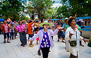 Villagers dance in a procession around the ordination hall to begin the festivities for the 2nd day of Songkran in rural Thailand. PHOTO BY LEE CRAKER