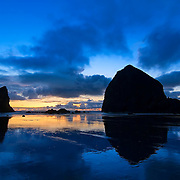 Sun has set over Cannon beach in Oregon.