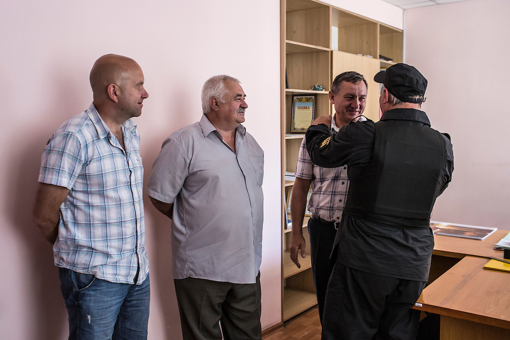 BILOZIRSKE, UKRAINE - MAY 21:  Members of the Donbass Battalion, a pro-Ukraine militia, meet with local politicians to ensure the integrity of the upcoming presidential election on May 21, 2014 in Bilozirske, Ukraine. Days before presidential elections are scheduled, questions remain whether the eastern regions of Donetsk and Luhansk are stable enough to administer the vote. (Photo by Brendan Hoffman/Getty Images) *** Local Caption ***