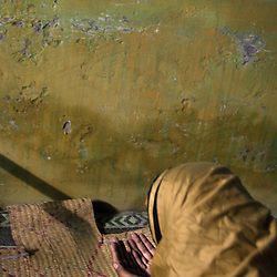 Mukhtar Mai, 33, prays inside her home, Meerwala, Pakistan, April 29, 2005. Mai, went against the Pakistani tradition of committing suicide when she brought charges against the men who gang raped her nearly three years ago.
