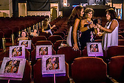 It is common for friends and families to place posters and signs of whoever they are supporting on chairs to reserve them before the pageant begins. Gina Hitchens made up signs with photographs of all four of her daughters who were all participating in the Miss Ohio pageant.