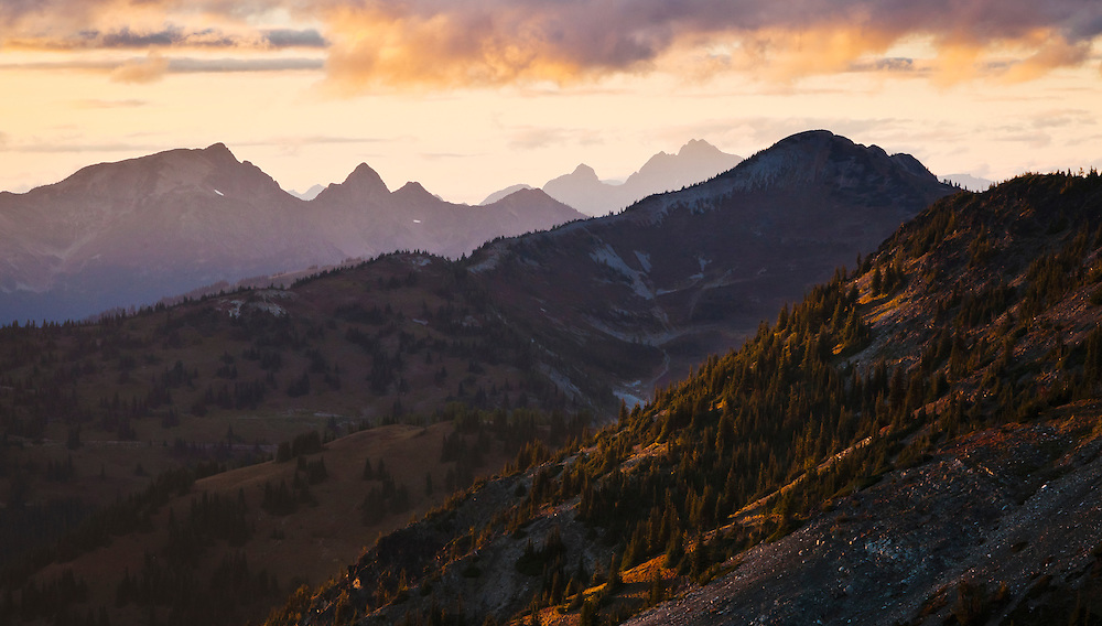 Mountain peaks and ridges in the north Cascades as seen from Slate peak near Harts Pass at sunset. Washington, USA.