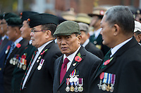 @Licensed to London News Pictures 13/11/2016. Maidstone, Kent. Veteran members of the British Armed Forces Queens Gurkha Regiment march to the war memorial for the Remembrance Day Service in Maidstone, Kent. Photo credit: Manu Palomeque/LNP
