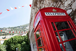 A red telephone box. Images of Gibraltar, the British overseas territory located on the southern end of the Iberian Peninsula at the entrance of the Mediterranean.
