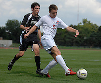 Ohio State midfielder Austin McAnena (11) passes the ball while defended by Binghamton defender Kevin Bunce (25) as OSU takes on Binghamton in the first half of an NCAA men's college soccer game in Columbus, Ohio on Sunday, Sept. 11, 2011, at Jesse Owens Memorial Stadium.