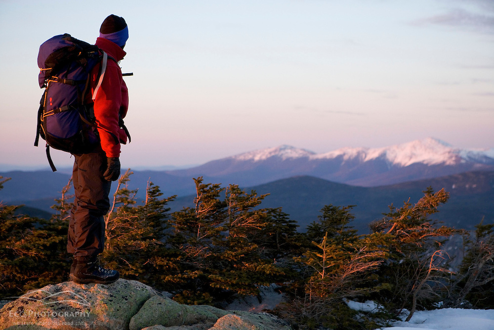 A backpacker looks at Mt. Washington from Mt. Bond in New Hampshire's White Mountains.  Pemigewasset Wilderness Area.
