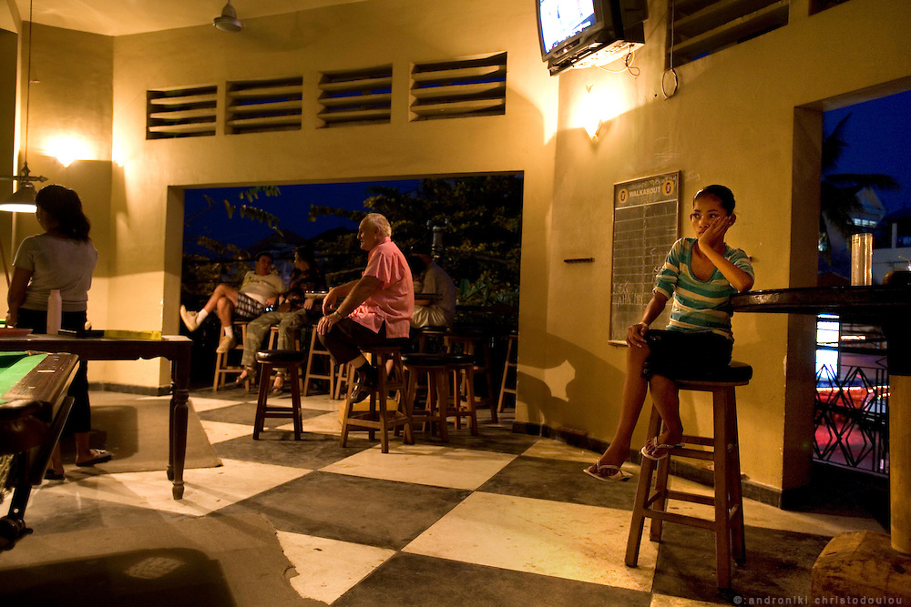 """Child trafficking and prostitution in Cambodia.Bar """"Walkabout"""" in Phnom Penh is one of the bars where young and many times underaged prostitutes go to pick up foreign clients. The bar also offers rooms for its customers on the upper floor."""