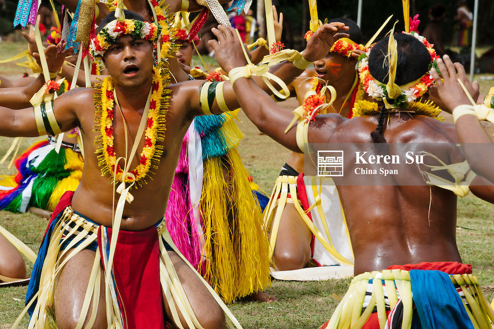 Yapese men in traditional clothing dancing at Yap Day Festival, Yap Island, Federated States of Micronesia