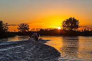 Sunset, Brazil; Mato Grosso; Pantanal, river, reflection, boat, boating