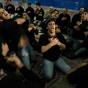 Inside Haram-e-motahar, the holy shrine of Imam Khomeini, a group of of boys hits themselves in sign of mourning.