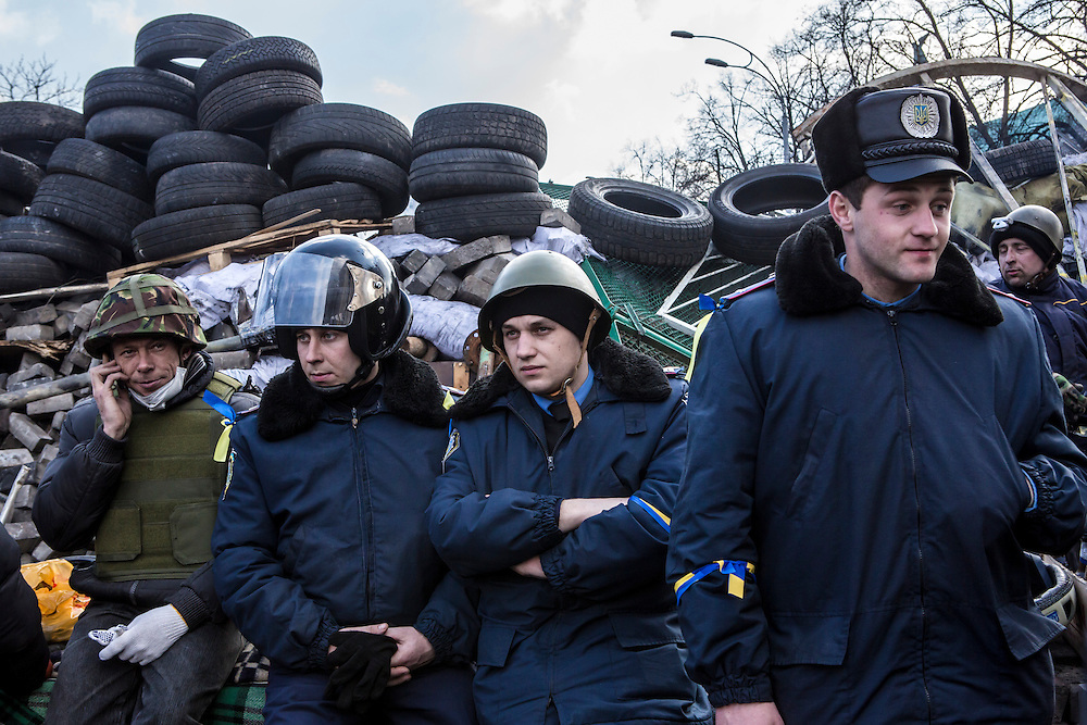 KIEV, UKRAINE - FEBRUARY 21: Interior Ministry police who have joined anti-government protesters stand near front-line barricades near Independence Square on February 21, 2014 in Kiev, Ukraine. After a week that saw new levels of violence, with dozens killed, opposition and government representatives reached an agreement intended to resolve the crisis. (Photo by Brendan Hoffman/Getty Images) *** Local Caption ***