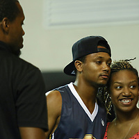 Actor and Rapper Romeo Miller son of well known rap mogul Master P, poses with a fan after participating in the 2014 Duffy's Hope Celebrity Basketball Game Saturday, August 2, 2014, at The Bob Carpenter Sports Convocation Center, in Newark, DEL.    <br /> <br /> Proceeds will benefit The Non-Profit Organization Duffy's Hope Youth Programming.
