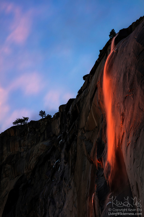 "Horsetail Fall, a 1,000-foot (305-meter) waterfall, appears like lava at sunset as it pours over the granite face of El Capitan in Yosemite National Park, California. The dramatic lighting effect, which has been called a ""firefall,"" appears in mid-to-late February if the weather conditions are just right."