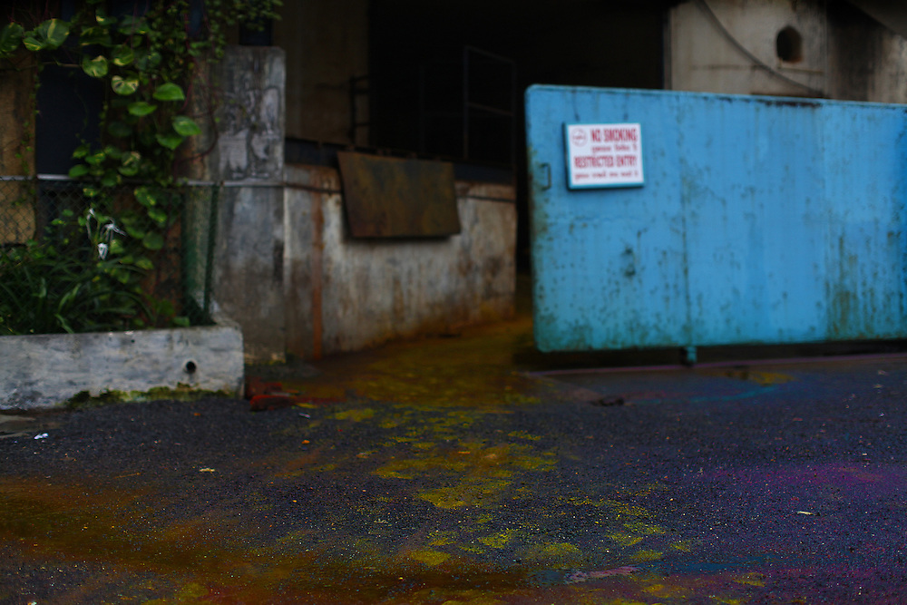 A rainbow of toxic footprints are tracked in and out of one of the chemical plants in VApi, India.