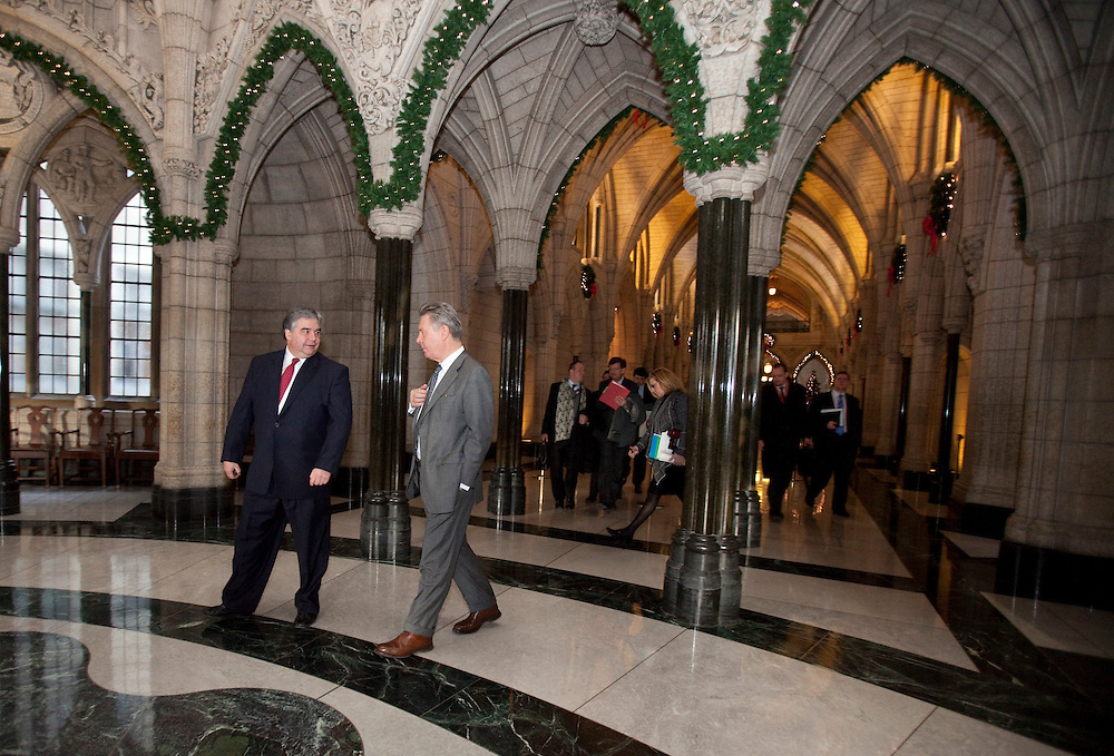 Karel De Gucht, European Commissioner for Trade tours Centre Block on Parliament Hill in Ottawa, Canada with Canada's Minister of International Trade Peter Van Loan December 15, 2010.<br /> AFP/GEOFF ROBINS/STR