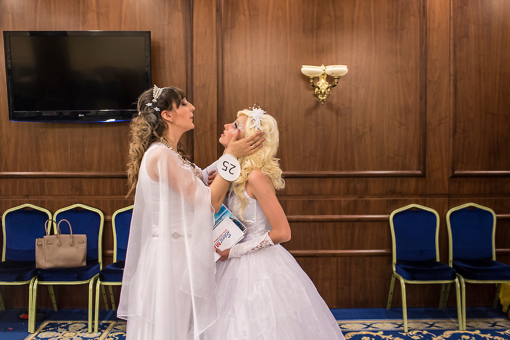 DONETSK, UKRAINE - MAY 18: Contestants at a bridal contest wait backstage on May 18, 2014 in Donetsk, Ukraine. A week before presidential elections are scheduled, questions remain whether the eastern regions of Donetsk and Luhansk are stable enough to administer the vote. (Photo by Brendan Hoffman/Getty Images) *** Local Caption ***