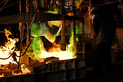 Kerin Finch - Smelter worker pouring molten copper to make anodes..