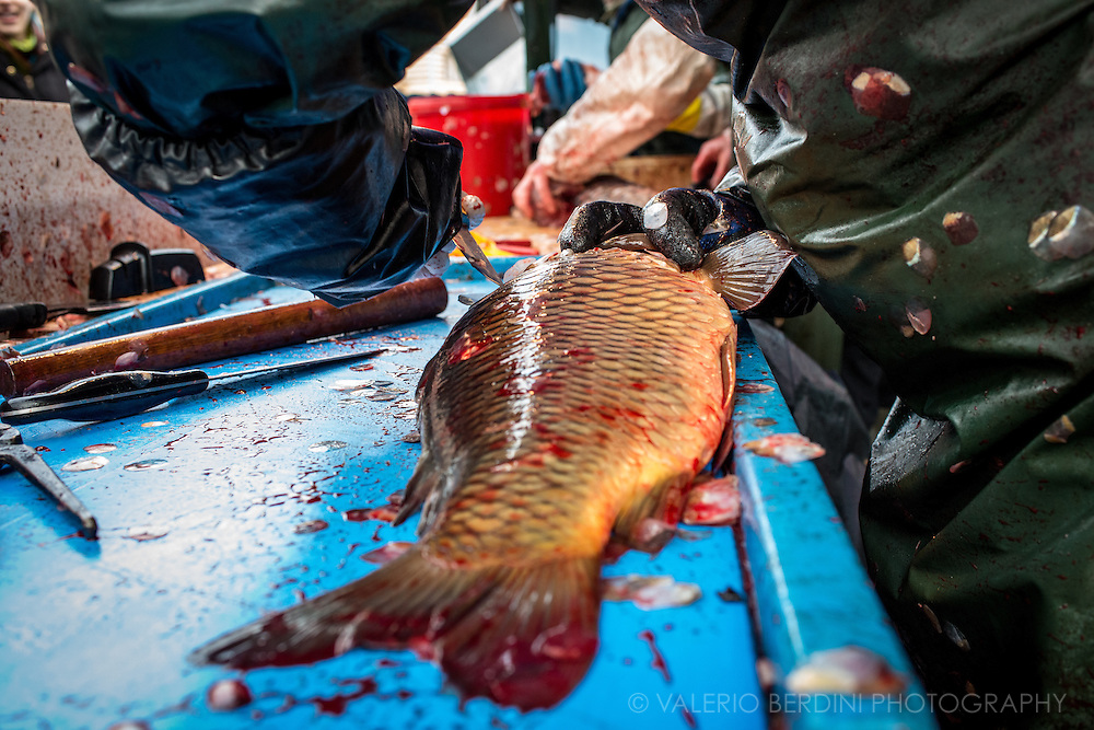 A skilled fishmonger uses several tools to get the work done.