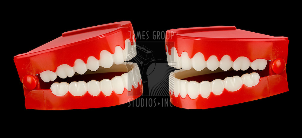 A pair of toy chattering teeth isolated on a black background with a clipping path