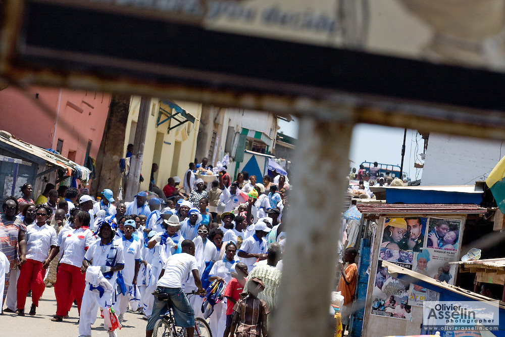 A group of people from the #2 Asafo company walk down a street as they prepare to take part in the parade held on the occasion of the annual Oguaa Fetu Afahye Festival in Cape Coast, Ghana on Saturday September 6, 2008.
