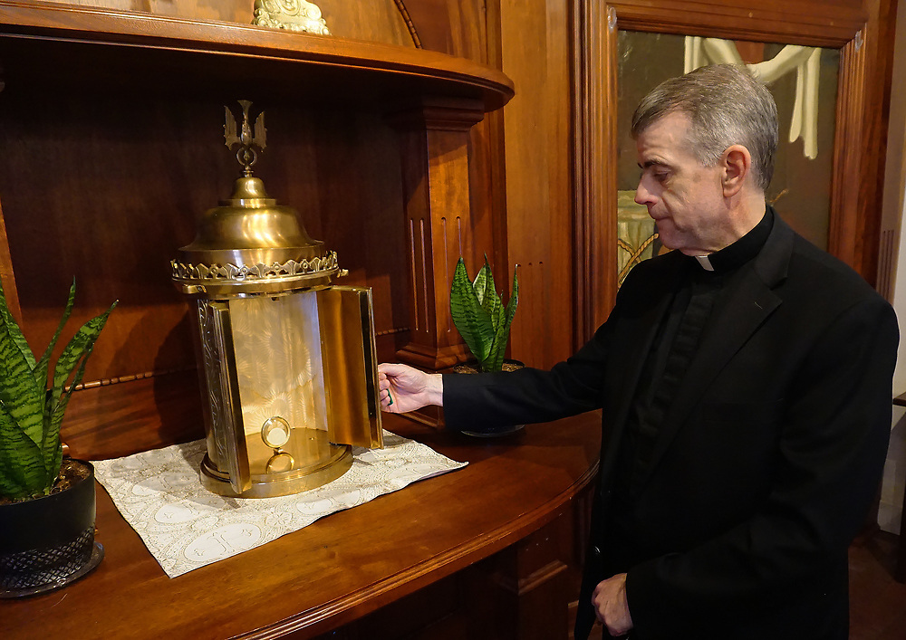 apl042617a/ASECTION/pierre-louis/JOURNAL 042617<br /> Father Andrew Pavlak,, of San Felipe de Neri Catholic Church inspects the recovered Tabernacle after it was stolen from the Old Town church earlier this month.  .Photographed on Wednesday April 26, 2017. .Adolphe Pierre-Louis/JOURNAL