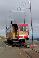Snaefell Mounatin Railway. Snaefell is Isle of Man's highest mountain, 621 m, and seven kingdoms can be seen from the mountain peak: Mann, Scotland, England, Wales, Ireland, Heaven and the Sea. It is possible to take a ride on the only electric maountain railway in the British Isles to the top. the Railway was build in 1895