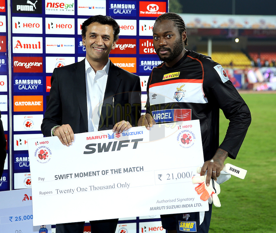 Edel Apoula Edima Bete of Atletico de Kolkata  recives Swift momment of the match award during the presentation of the  match 44 of the Hero Indian Super League between FC Pune City and Atletico de Kolkata FC held at the Shree Shiv Chhatrapati Sports Complex Stadium, Pune, India on the 29th November 2014.<br /> <br /> Photo by:  Sandeep Shetty/ ISL/ SPORTZPICS