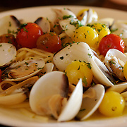 Clam pasta with organic garlic and cherry tomatoes is seen Friday, Sept. 7, 2007 at Cafe Dodaci in Washington, Iowa. Photo by Scott Morgan