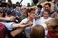 Former Alaska governor Sarah Palin talks to reporters at the Iowa State Fair on Friday, August 12, 2011 in Des Moines, IA.