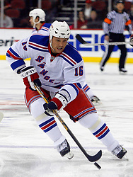 February 1, 2008; Newark, NJ, USA;  New York Rangers left wing Sean Avery (16) skates with the puck during the first period at the Prudential Center in Newark, NJ.