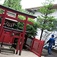 A small shrine outside the Kato factory (a light industry company) in Nakatsugawa, Japan, Monday 21st June 2010. Kato company has a workforce of 100 people, 50% of whom are 60 years of age or older. The elderly work force earn JPN ¥800-1,000 per hour, but receive no annual bonus or pay rise.