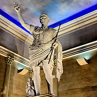 Caesar Statue Inside Caesars Atlantic City in Atlantic City, New Jersey<br /> Gaius Julius Caesar was the Roman Republic&rsquo;s &ldquo;dictator of perpetuity&rdquo; until his assassination by Brutus on the Ides of March in 44 BC. Today, his name is associated with Caesars Entertainment&rsquo;s signature properties in Las Vegas and Atlantic City. The company has 60 other hotels, resorts and casinos under various brands. This statue in their New Jersey hotel lobby is Augustus. He became the first Roman Empire emperor a few years after his father&rsquo;s death. In the corner is Cupid riding a dolphin. The statue replicates the Augustus of Prima Porta. That famous sculpture was carved from white marble in 20 AD and is now in the Vatican Museum in Rome.