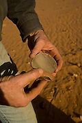 Philip Gee shows what he feels are possibly rocks that were split by aboriginal people may  several generations ago used in their food preparation.. Explore the Outback camel safaris are based in the central Australian deserts near William Creek along the Oodnadatta Track (Lake Eyre, South Australia), and operate from April through to October every year.